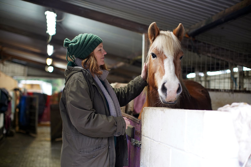 Picture of Kayte with one of the horses at the Heart Centre © Big Leaf Foundation