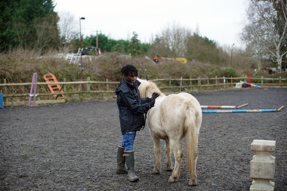 Picture of B with his horse © Big Leaf Foundation