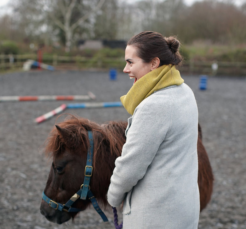 Picture of Jo with one of the ponies at the Heart Centre © Big Leaf Foundation