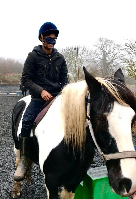 Picture of one of the boys sitting on his horse blindfolded © Big Leaf Foundation